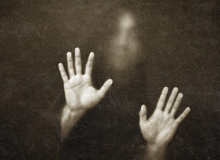 shadowy: Shadowy figure behind dusty glass scratched Stock Photo
