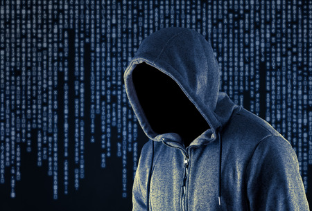 hooded: Hooded computer hacker Stock Photo