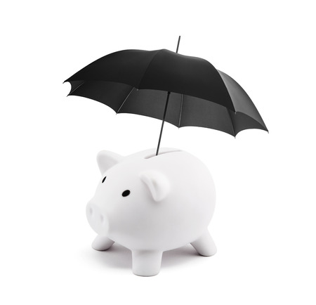 Financial insurance. White piggy bank with umbrella Stock Photo