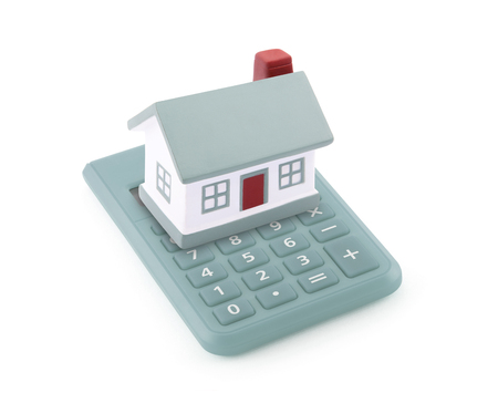 paying: Small toy house on calculator