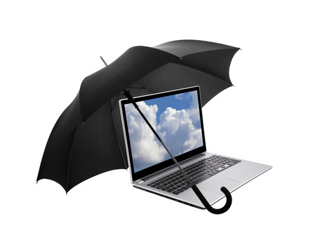 Laptop protected by an umbrella