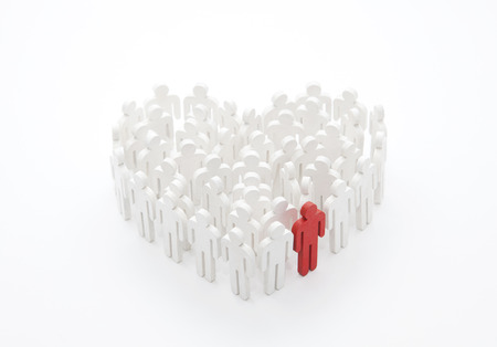 Group of people in the shape of a heart with one red person Reklamní fotografie