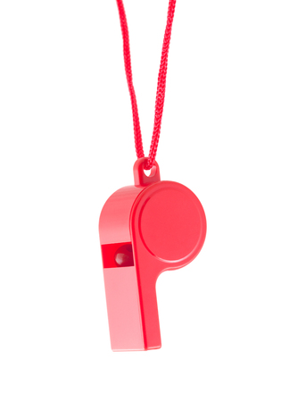 Red plastic whistle on a white background Imagens