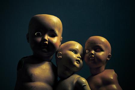 Three creepy dolls