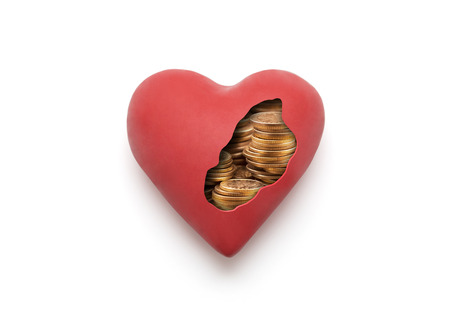 Red heart with golden coins over white background with clipping path Stock Photo