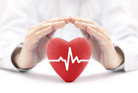 Heart pulse covered by hands. Health insurance concept