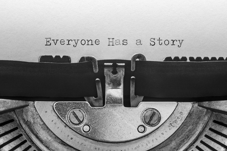 Everyone has a story typed on a vintage typewriter Banco de Imagens