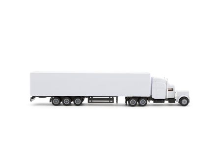 White long miniature truck with a trailer on a white background. Clipping path included.