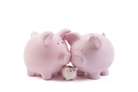 Three piggy banks on white background with clipping path