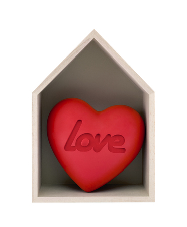Wooden house and red heart with imprinted word love isolated on white with clipping path