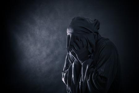 Scary figure in hooded cloak Foto de archivo