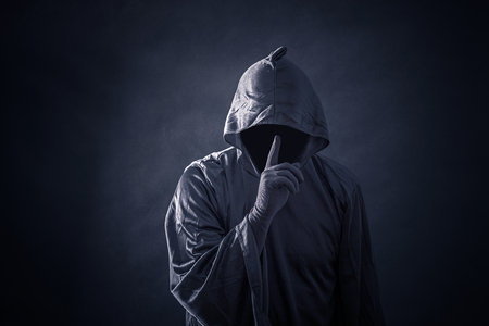 Scary figure in hooded cloak 免版税图像