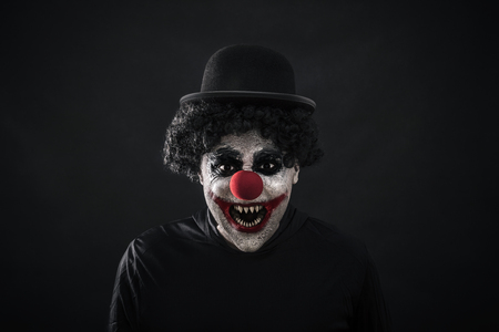 Scary clown showing his sharp pointy teeth 免版税图像
