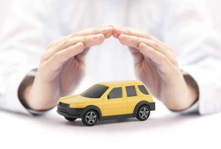 Car insurance concept with yellow car Stock Photo
