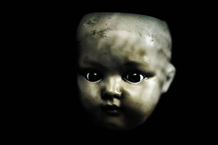 Creepy doll in the dark
