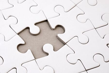 Last piece of jigsaw puzzle Stock Photo