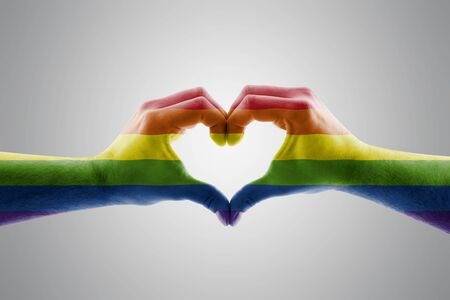 Two hands in the form of LGBT rainbow heart symbol of love
