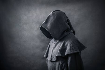Scary figure in hooded cloak Banco de Imagens