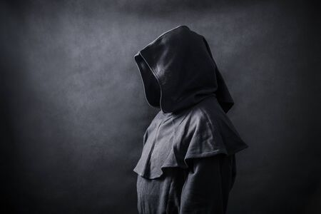 Scary figure in hooded cloak Reklamní fotografie