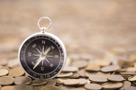 Financial concept with coins and compass