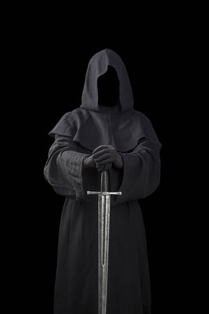 Ghostly figure with medieval sword isolated on black