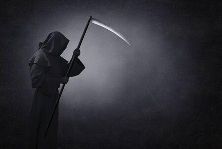 Grim reaper with scythe in the dark 版權商用圖片