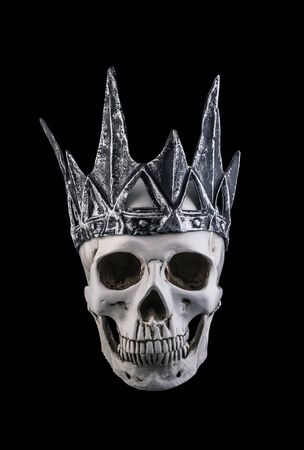 Human skull with crown isolated on black background