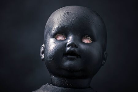 Creepy doll in the dark