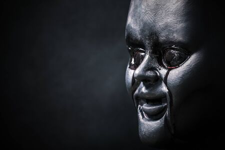 Creepy bloody doll head in the dark