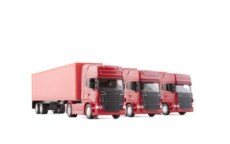 Group of three red long trucks with a trailers isolated on white background