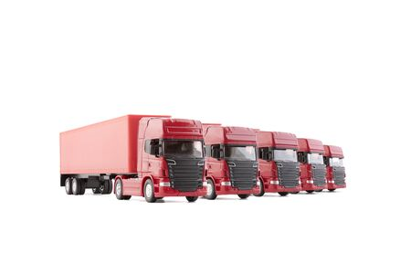 Group of five red long trucks with a trailers isolated on white background Archivio Fotografico