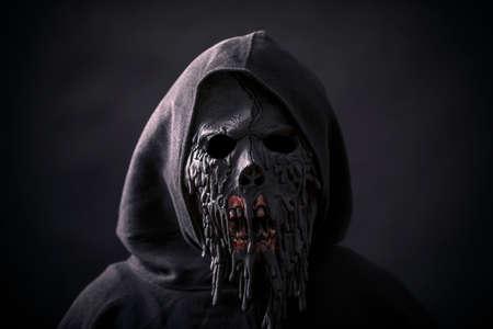 Scary figure in hooded cloak with mask Reklamní fotografie