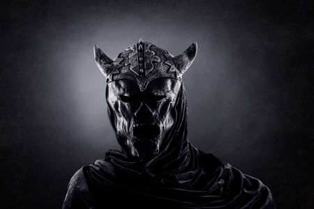 Demon with horned helmet in the dark Banque d'images