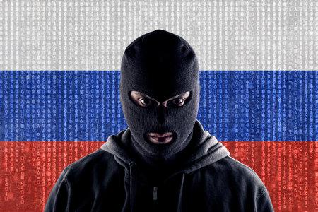 Russian masked computer hacker with black balaclava Stock Photo
