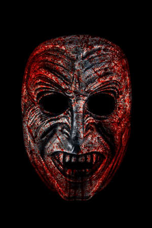 Creepy bloody vampire head isolated on black with clipping path