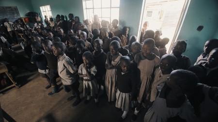 KENYA, KISUMU - MAY 20, 2017: Crowd of african children standing in big classroom. Boys and girls from poor african village. Redakční