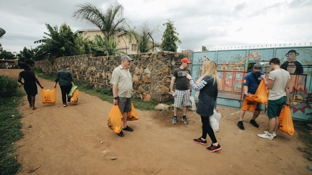 KENYA, KISUMU - MAY 20, 2017: Group of Caucasian people with packages. The volunteers traveled to Africa to help the poor families.