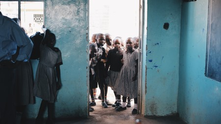 KENYA, KISUMU - MAY 20, 2017: Group of children in uniform comes into class and prepares for lesson at school in Africa. Redakční