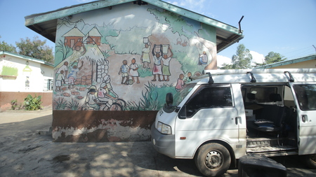KENYA, KISUMU - MAY 23, 2017: Camera shoots the wall of the African house. Beautiful colored ethnic pictures on the wall. Redakční