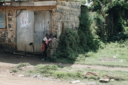 KENYA, KISUMU - MAY 20, 2017: Young african children in sunny day.