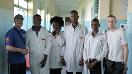KENYA, KISUMU - MAY 20, 2017: Young beautiful people, women and man in white gown in African hospital. Redakční