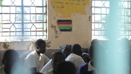 KENYA, KISUMU - MAY 23, 2017: Close-up fiew of three african boys in uniform sitting in classroom in school Redakční