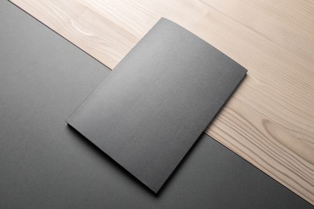 Blank Notebook Mock-up on black and wooden background Banco de Imagens