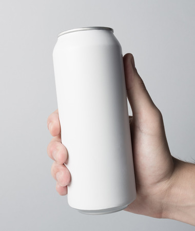 replace: Blank Can in hand on white background, ready to replace your design Stock Photo