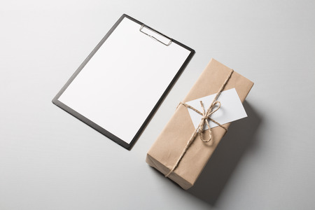 clip board: Clip board with blank paper and package.