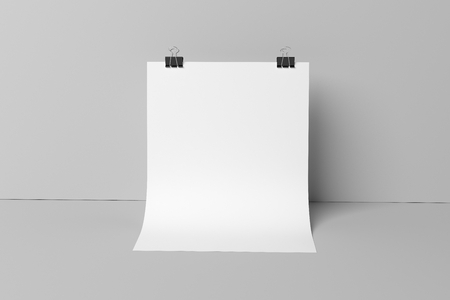 binding: Blank poster on the wall with binding clips Mock up