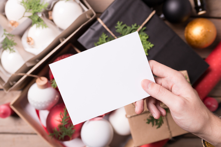 newyear: Christmas  New Year set with hand holding blank white flyer and dof background