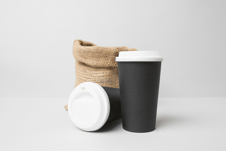 Black paper cups mockup with coffee sack Banco de Imagens