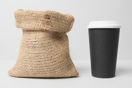 Black paper cup mockup with coffee sack