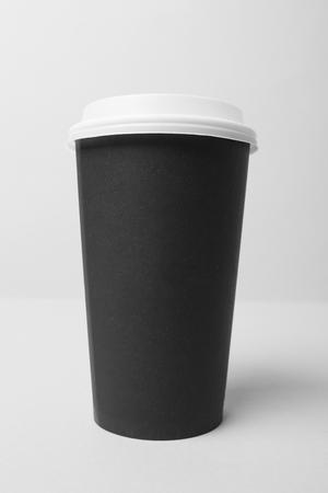 Blank black paper cup with white cap Reklamní fotografie